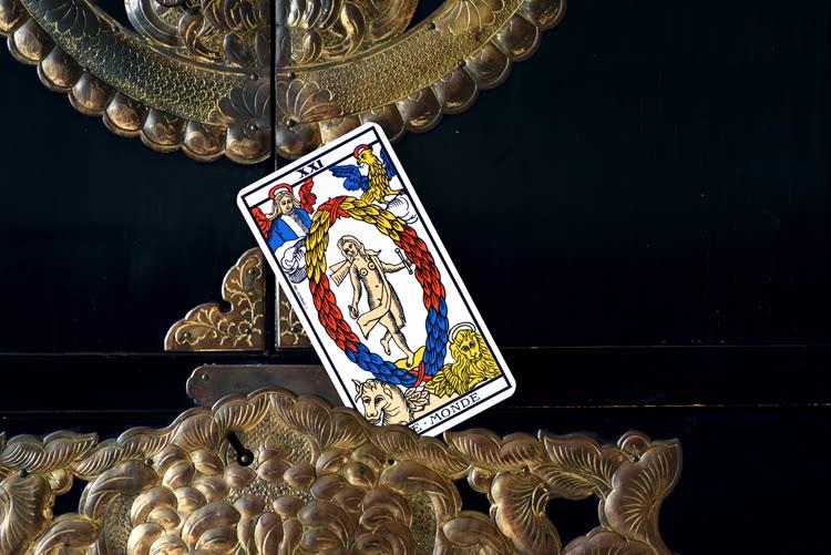 Le nom de Le Monde dans le tarot